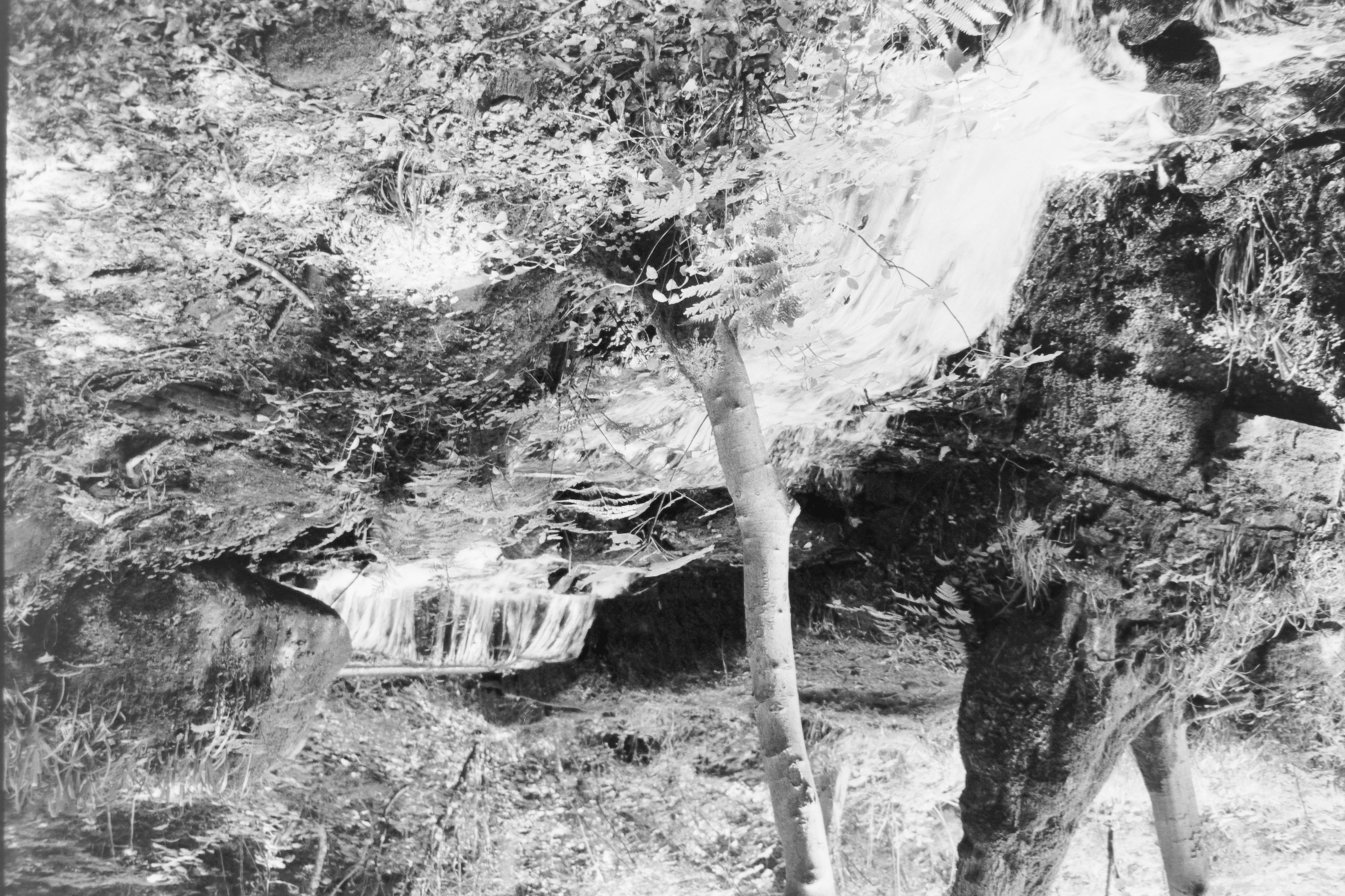 a badly exposed photo of a waterfall in the loxley valley